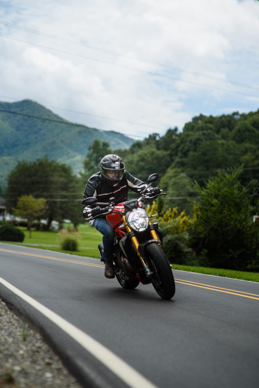 groom rides his ducati on the tail of the dragon before his wedding ceremony