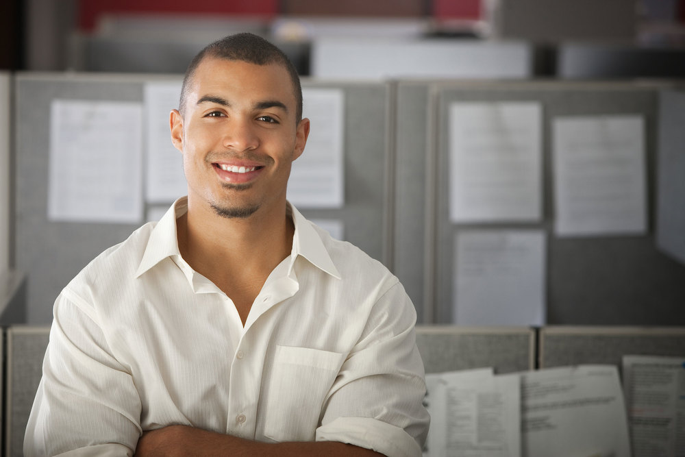 man standing next to cubicle