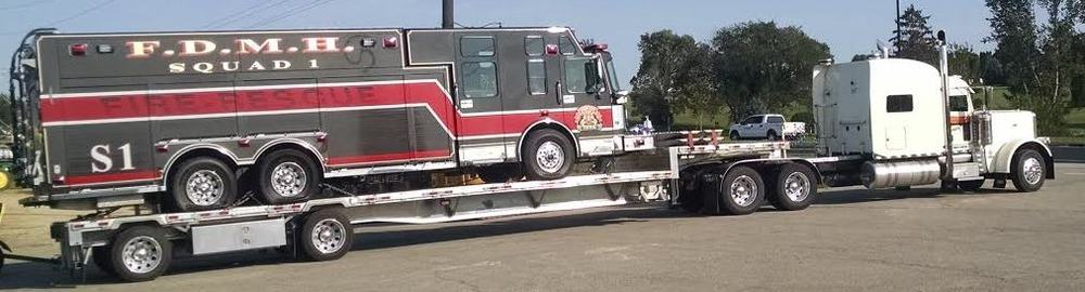 Squad 1 is loaded on a low-boy and secured bound for it's new home in Greenville, NY.