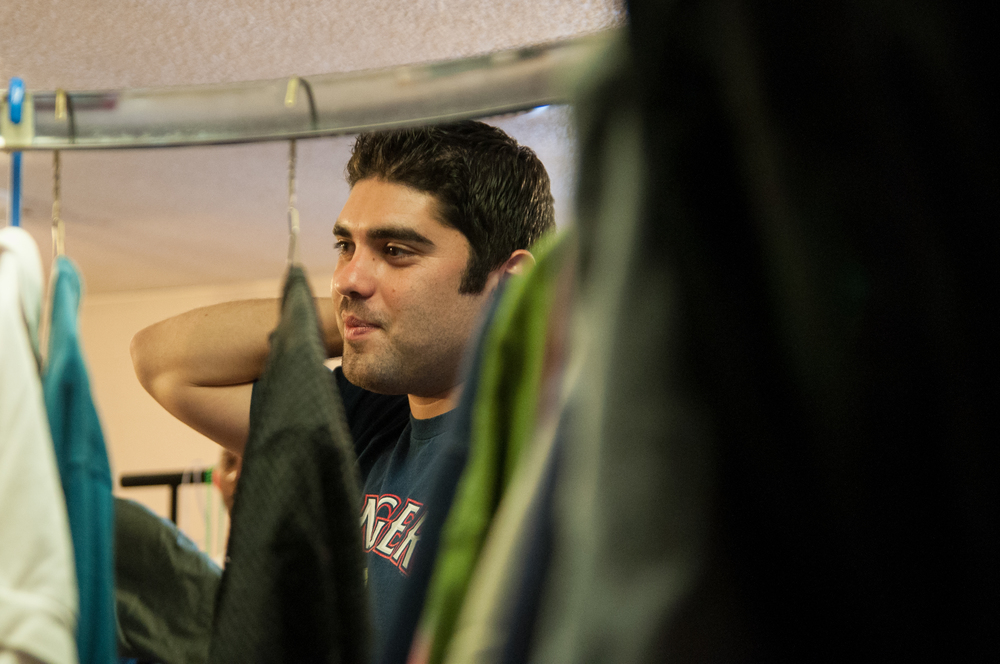 Cardona watches as volunteers (not pictured) fold and organize the clothing room of the store Wednesday, Sept. 25. Cardona has designated a specific room for shopping and a separate community room for enjoying coffee and conversation.