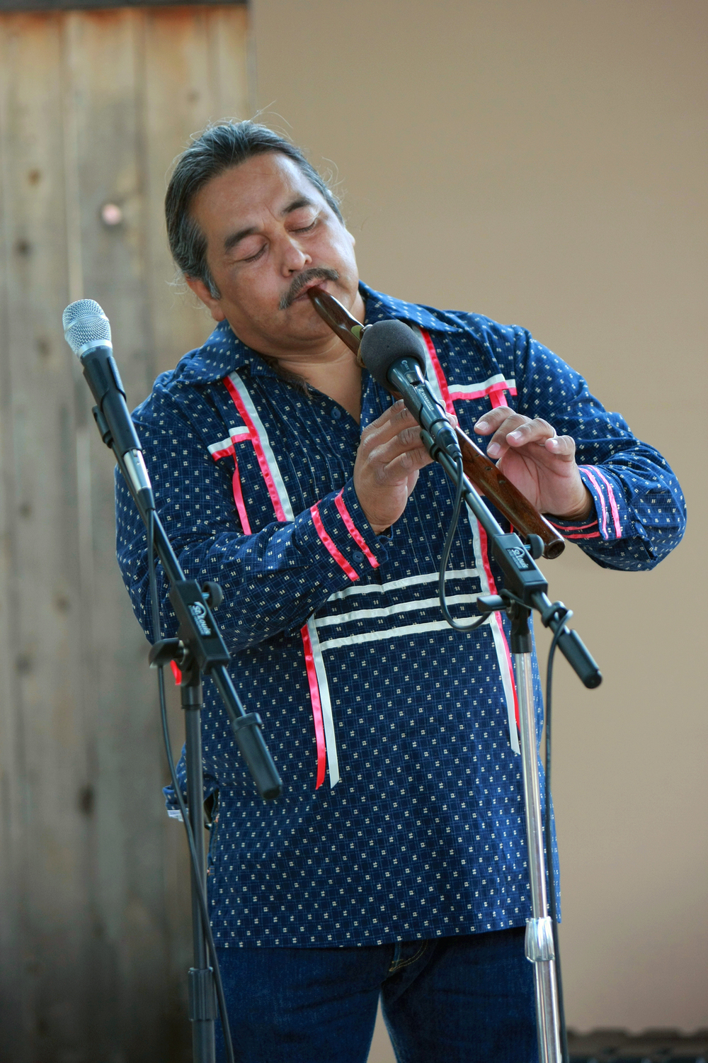 Alex  Maldonado plays a flute made from river cane.