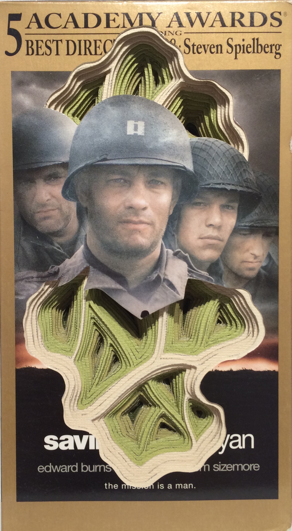 Saving Private Ryan , 2015 hand-cut paper and VHS cover,   7.5 x 4.25 x 1, $200.