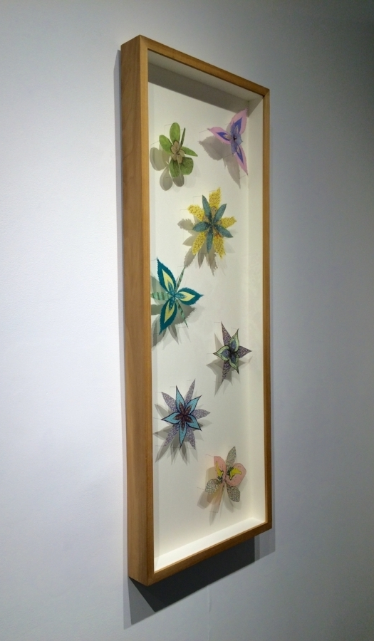 Installation view,  Colorburst Pinwheels , 2014, digital prints and hand-colored lithographs on hand-cut tissue weight kozo and gampi papers, entomology pins, and acid-free foam core, 41 x 16 x 2.25 inches (framed), $4500. (framed)