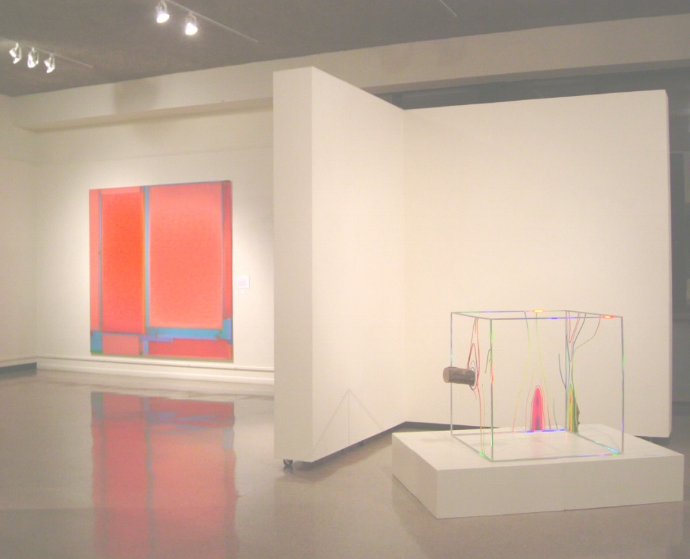 Julian Jackson,  Fugitive , 2005, oil on panel, 96 x 96 inches (left wall)  David Shaw,  Knot , 2004, holographic laminate and paint on steel and wood, 33.75 x 46.5 x 37.75 inches (right, on pedestal)