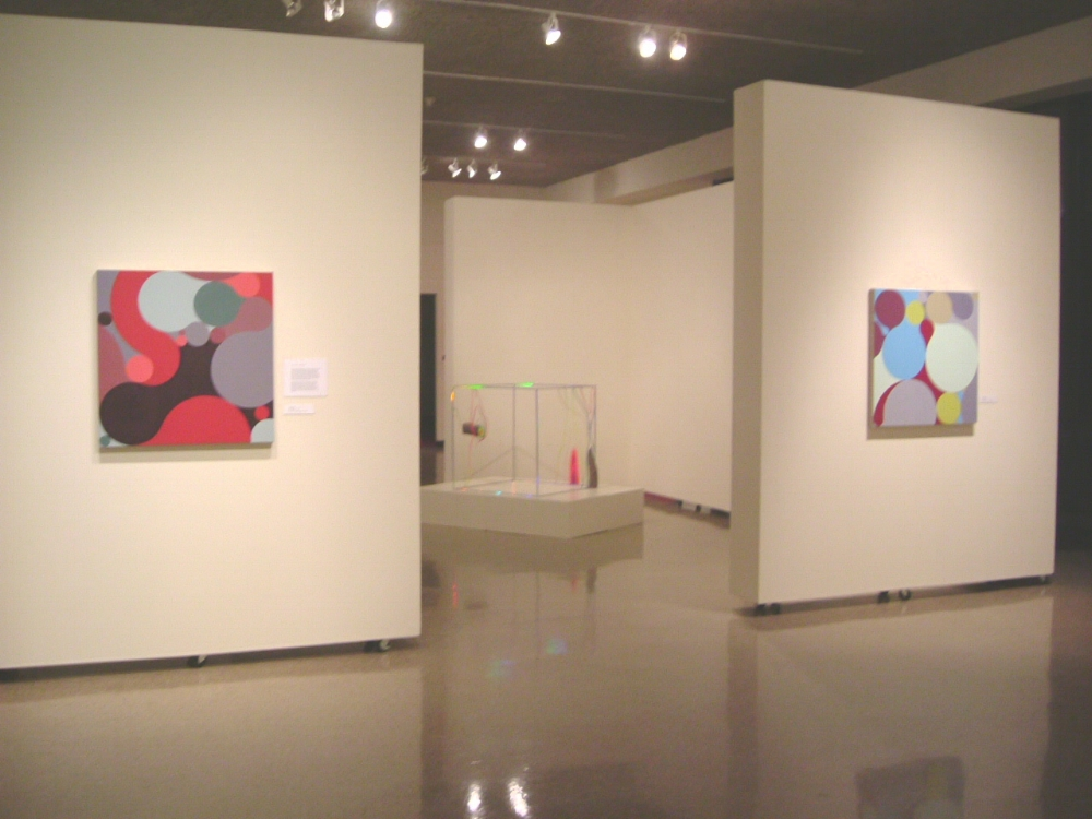 Julie Gross,  Two One Punch , 2004, oil on linen, 32 x 32 inches (left wall) Julie Gross,  Peri Airy , 2002, oil on linen, 32 x 32 inches (right wall)