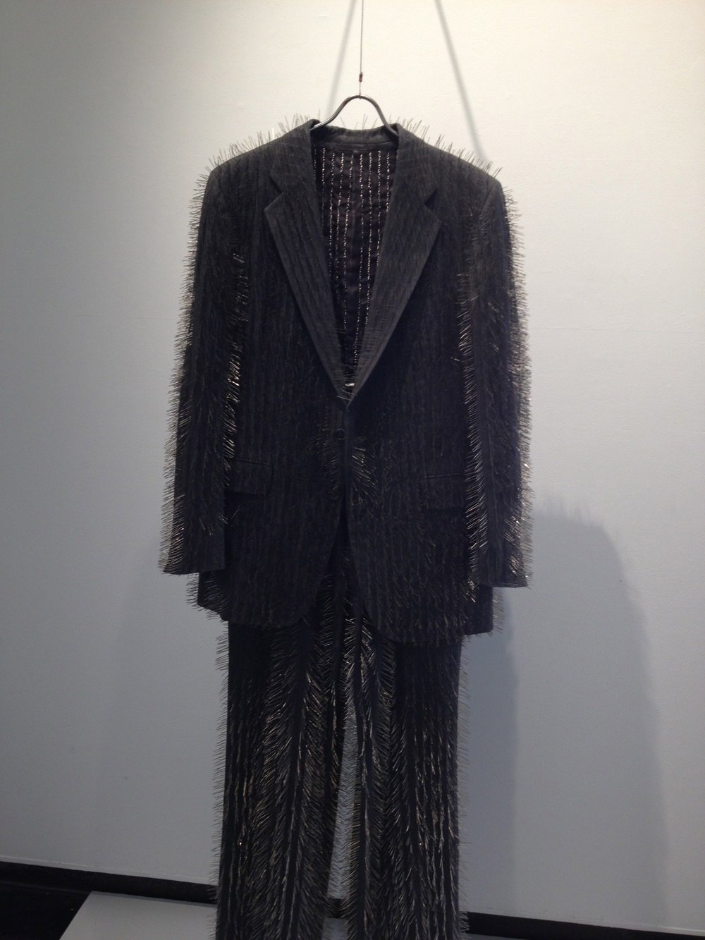 Eleanor White,  Pin Stripe Suit , 2002, pins, fabric, 62 x 24 x 7 inches
