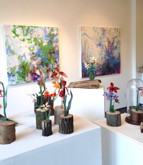 Glass flowers with paintings by Melanie Kozol (installation view)