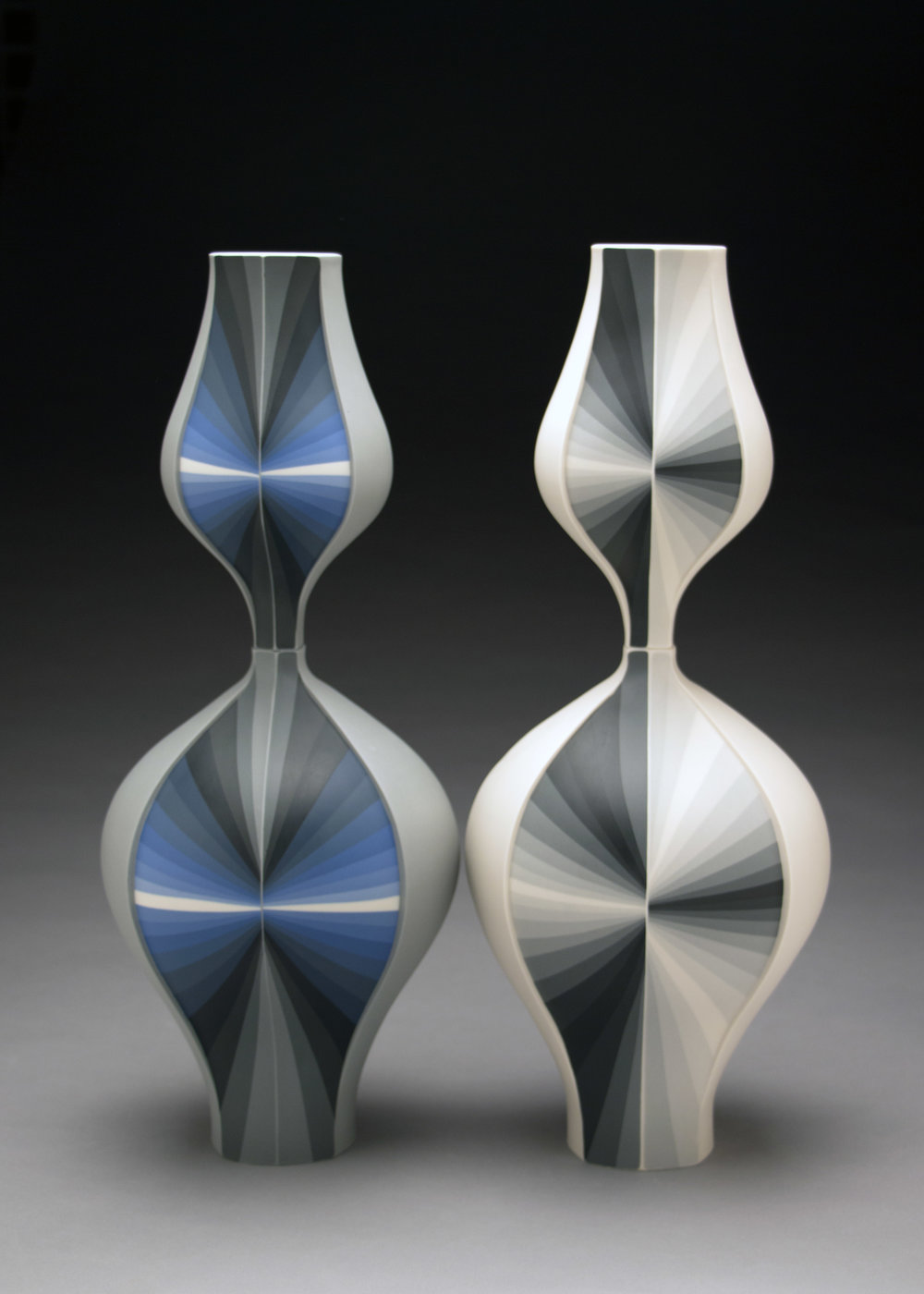 Peter Pincus,  Blue Contrasting Gradient Vessel  and  Grey Contrasting Gradient Vessel  (Side A), 2018, colored porcelain, gold luster, 20 x 8 x 8 inches, $4200. (each)