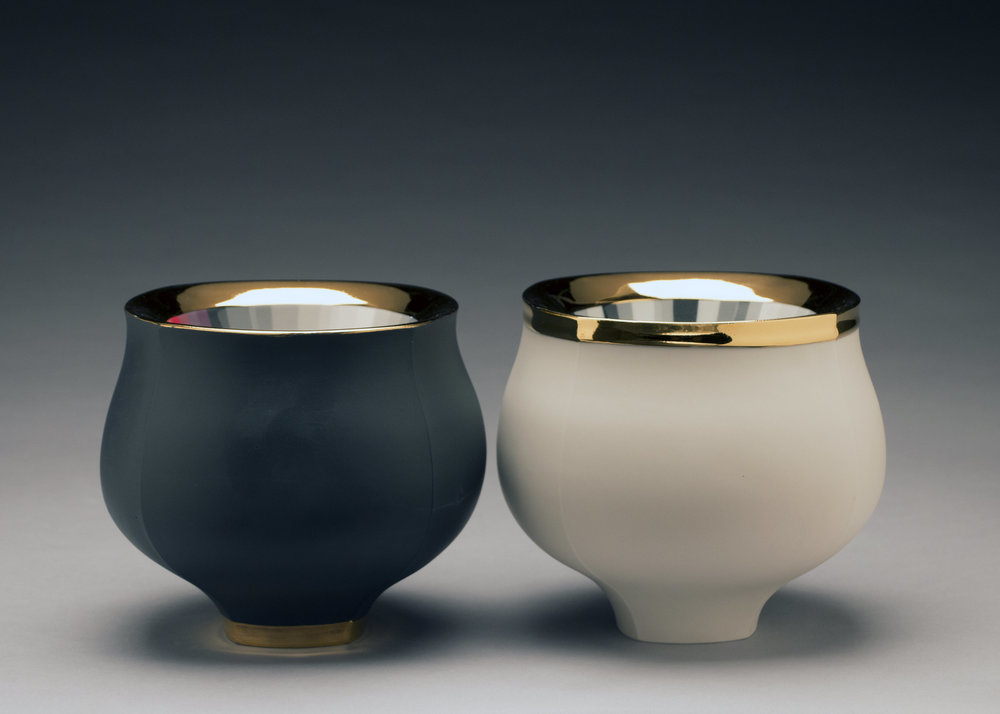 Peter Pincus,  Black Bowl  and  White Bowl  (side view), 2018, colored porcelain, gold luster, 6.5 x 8 x 8 inches, $2200. (each)