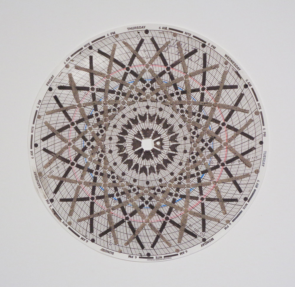 Eleanor White,  Graph Mandala 009 , 2018, wood ash, glass beads, polymer medium on hygrothermograph paper, 12 x 12 inches (framed), $450. (framed)