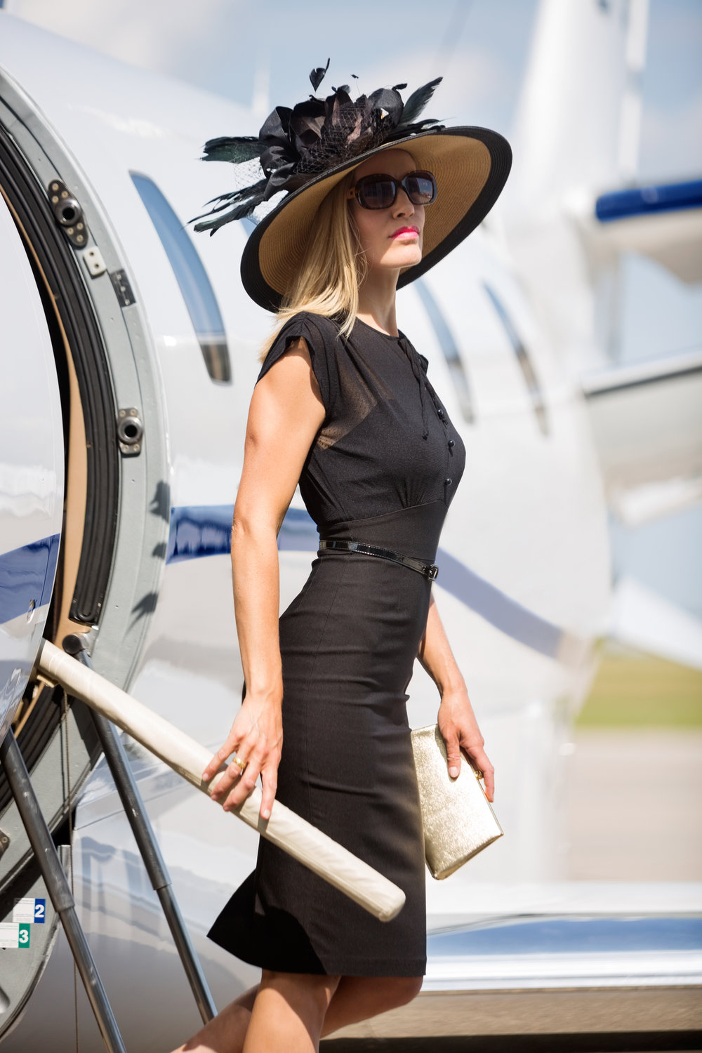 Wealthy Woman Getting Off Private Jet