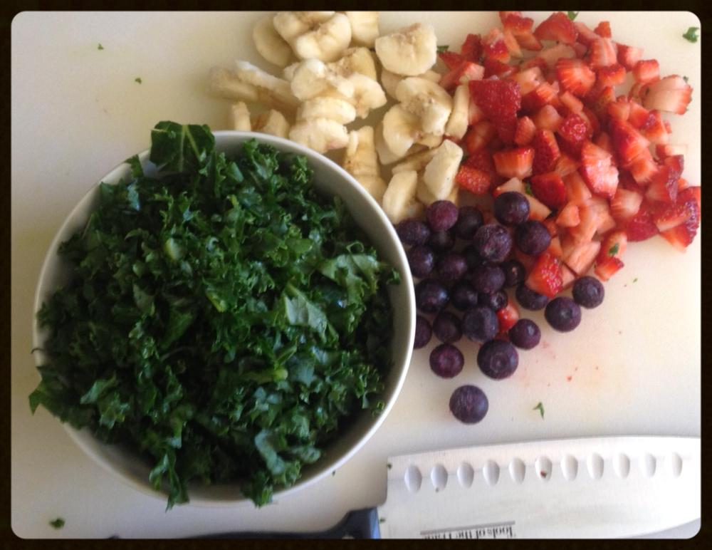 HALF GREENS!     greens- kale, fruit- strawberries and blueberries, fat- banana