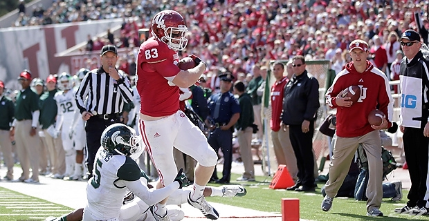 Tight End Ted Bolser lunges trying to reach the end zone against Michigan State