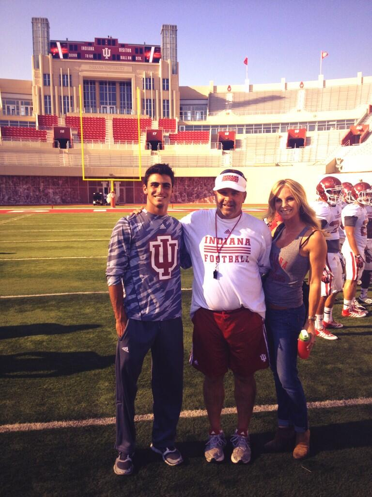 Zander Diamont on the field with Coach Wilson at Memorial Stadium during a campus visit.