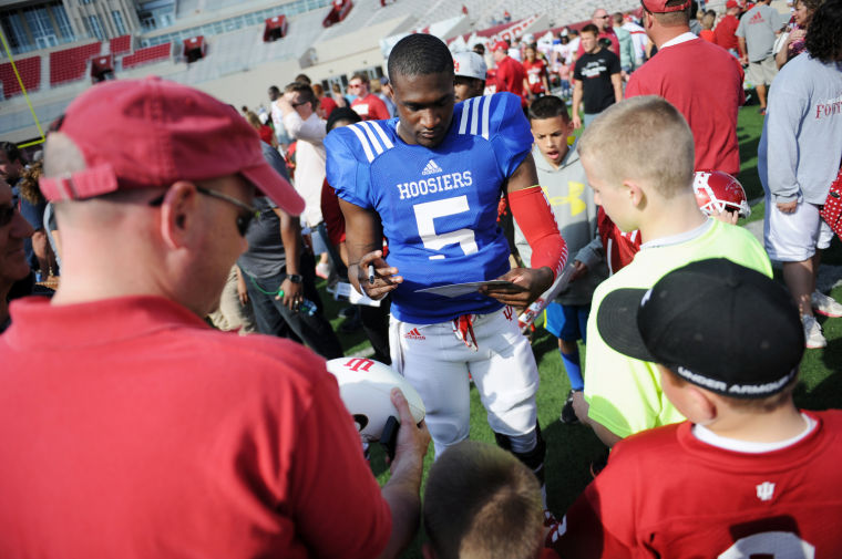 Tre Roberson signs for fans following the Cream and Crimson Game. Image Source: Herald Times