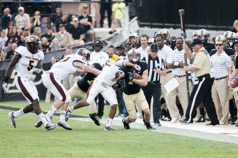 Purdue ball carrier stopped short if a first down by Central Michigan defenders