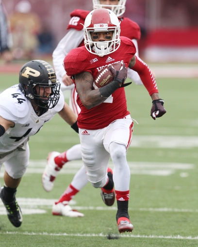 Shane Wynn, another departure, breaks away for the 41 yard touchdown run. Mandatory Credit – Pat Lovell USA TODAY Sports