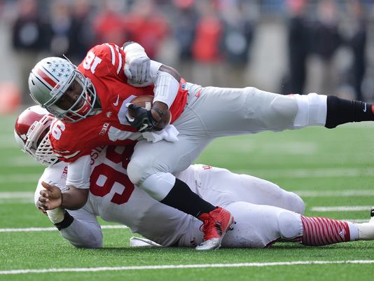 Hoosiers' Defensive Tackle Darius Latham sacks Buckeyes' Quarterback J.T. Barrett. Latham will be returning for his junior season with the Hoosiers and is one of the many reasons why fans are optimistic about the team's future on defense. Photo Credit - Jamie Sabau - Getty Images