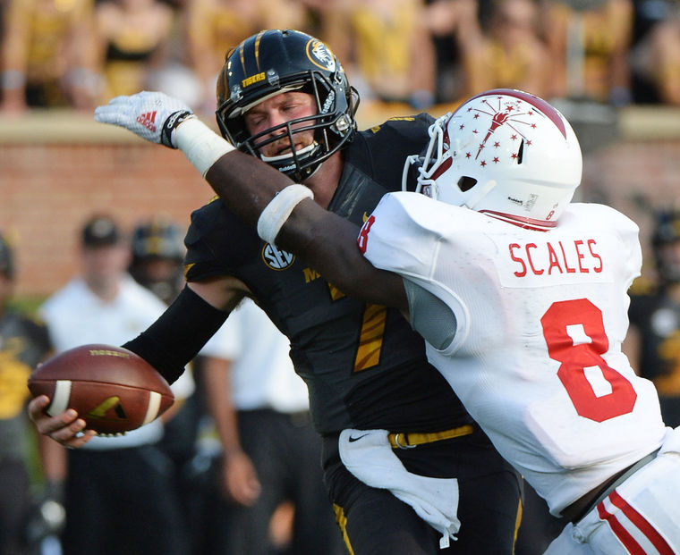 Linebacker Tegray Scales gets to Missouri Quarterback Maty Mauk for the sack.   Scales was an impact player for the Hoosiers in his first semester on campus  . Photo Credit - Herald Times - Chris Howell