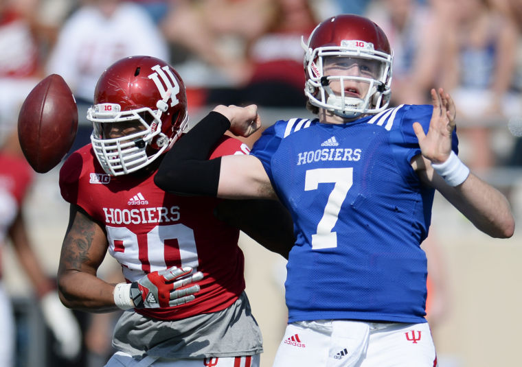 Former Indiana Defensive David Kenney gets to Quarterback Nate Sudfled during the Hoosiers 2014 Spring Game. Kenney is headed to Normal, Illinois to continue his career with the Illinois State Redbirds.