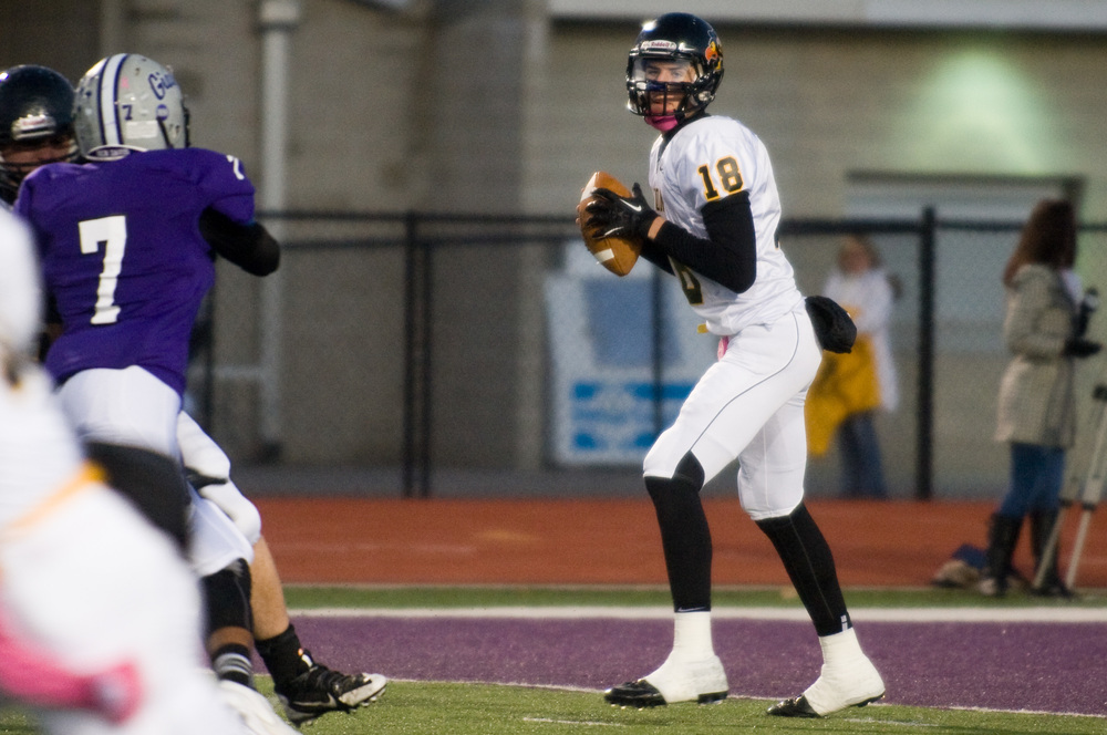 Avon Quarterback Brandon Peters scans the field for an open receiver while playing Ben Davis last fall. The Hoosiers are among several teams that are in pursuit of this highly-touted athlete.