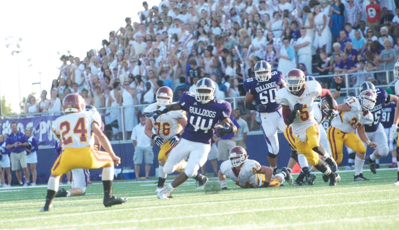 Brownsburg Running BackToks Akinribade carrying the ball in 49-28 victory overMcCutheonin 2013.The Hoosiers are hopeful they can keep this talented athlete in Indiana. Photo Credit - Brownsburg Athletics