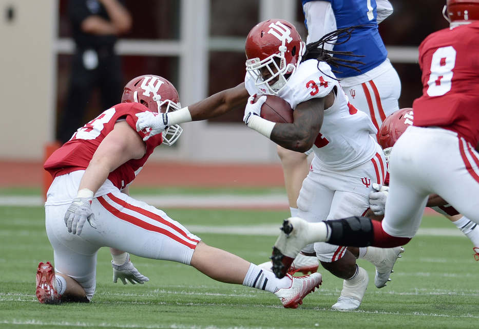 Devine Redding breaks a tackle during the Cream and Crimson game. Photo: HoosierScoop