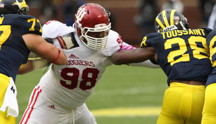 Indiana Defensive Tackle Darius Latham sheds a Michigan blocker before getting a hand on Running Back Fitzgerald Toussaint. Photo Credit - TMnews.com