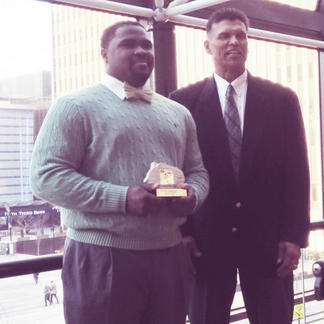 Mike Barwick Jr. receiving an Award from the Anthony Munoz Foundation for being the top Defensive Lineman in Ohio's Division VI.
