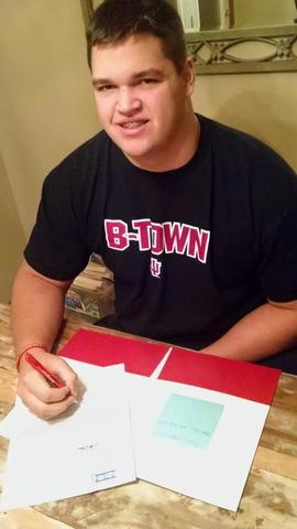 Offensive Lineman Simon Stepaniak signing his National Letter of Intent.