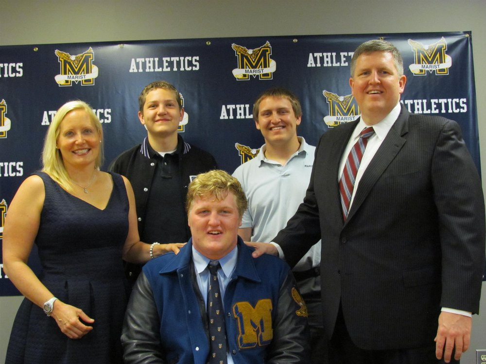 Incoming freshman offensive lineman Jack Trainor and his family during the his high school's signing day festivities earlier this year. Photo Credit - Marist School