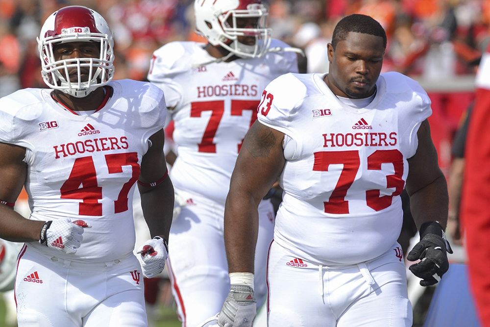 Robert McCray III and Bernard Taylor leave the field after the Hoosiers heartbreaking loss to Bowling Green last season. Photo Credit IDS