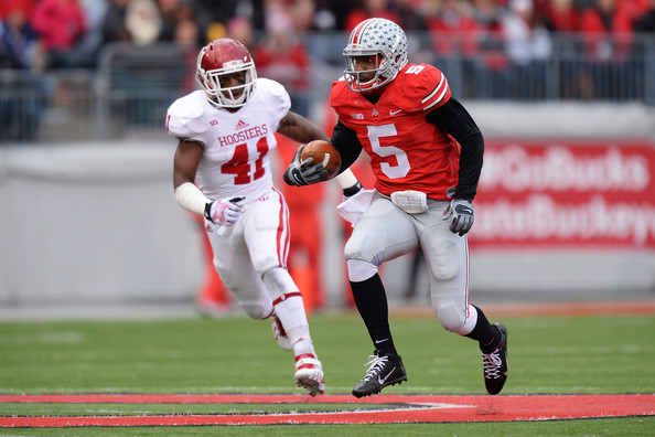 Clyde Newton chases down Ohio State's Braxton Miller during the team's showdown during the 2013 season. Newton looks to be a major contributor at linebacker this fall. Source: Jamie Sabau/Getty Images North America