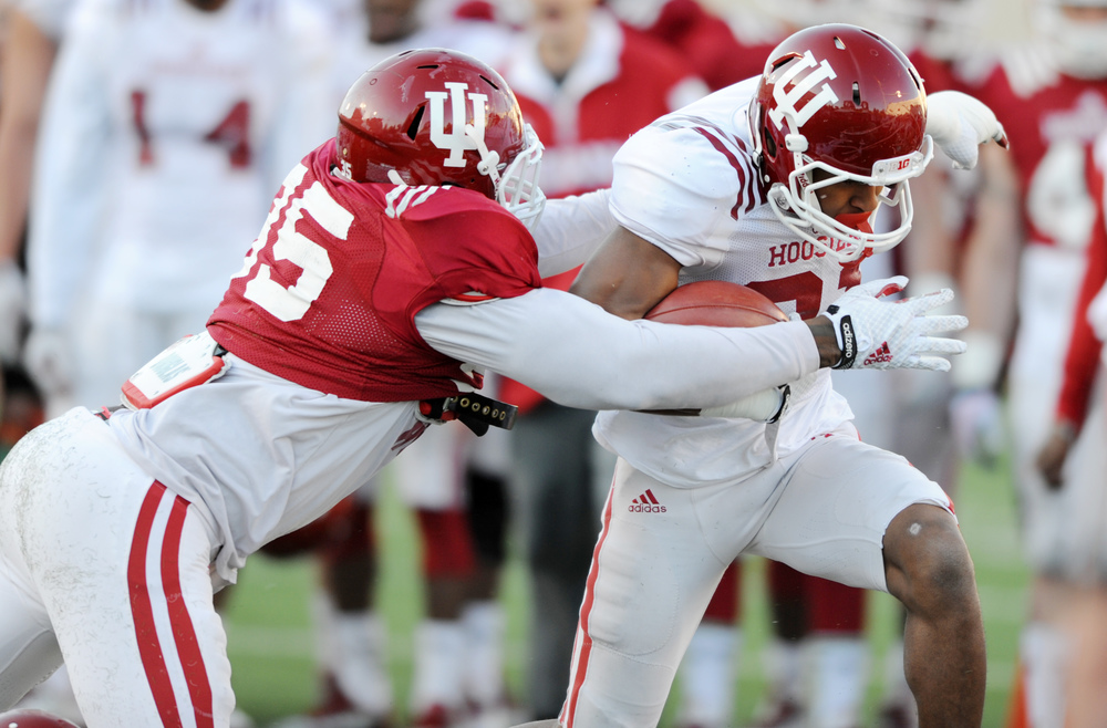 Andre Booker (31 white) could see more time this season at WR. Image: IUHoosiers.com