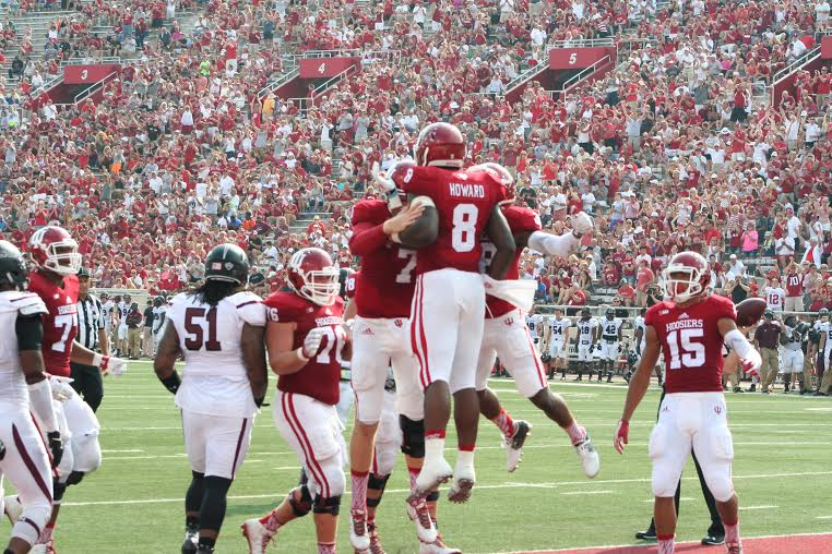 Jordan Howard (8) leads IU to a 48-47 win over Southern Illinois with 145 yards rushing and three touchdowns.  Image: Cam Koenig, HoosierHuddle.com