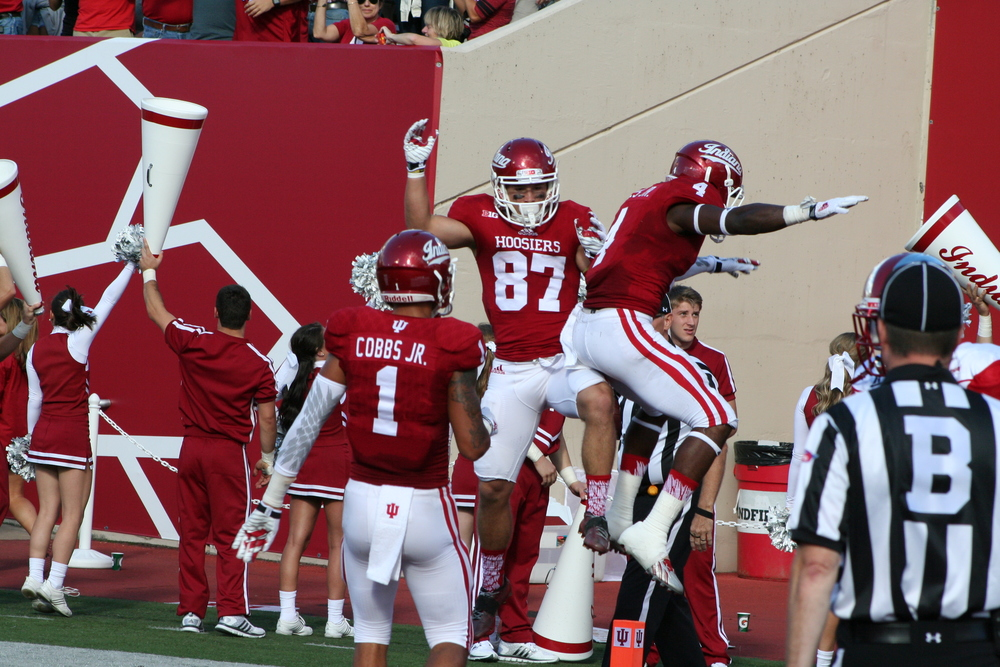 Hoosiers Wide receivers Ricky Jones and Mitchell PAige celebrate a second quarter touchdown by Jones as Simmie Cobbs looks on.