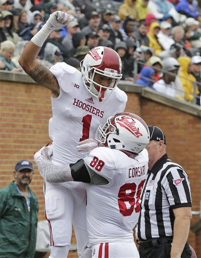 Indiana's Simmie Cobbs Jr. (1) celebrates his touchdown catch against Wake Forest with Anthony Corsaro (88) during the first half of an NCAA college football game in Winston-Salem, N.C., Saturday, Sept. 26, 2015. CHUCK BURTON — AP Photo