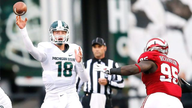 Connor Cook threw for 398 yards and four touchdowns.