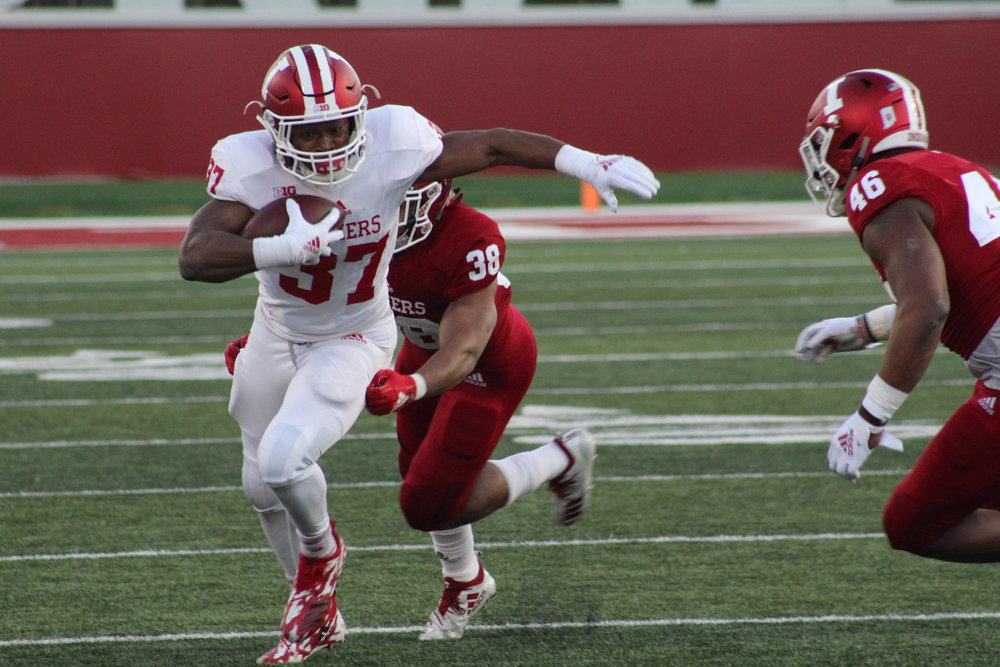 Ahrod Lloyd eludes the defense in a 48-33 Cream victory  Image: Sammy Jacobs Hoosier Huddle