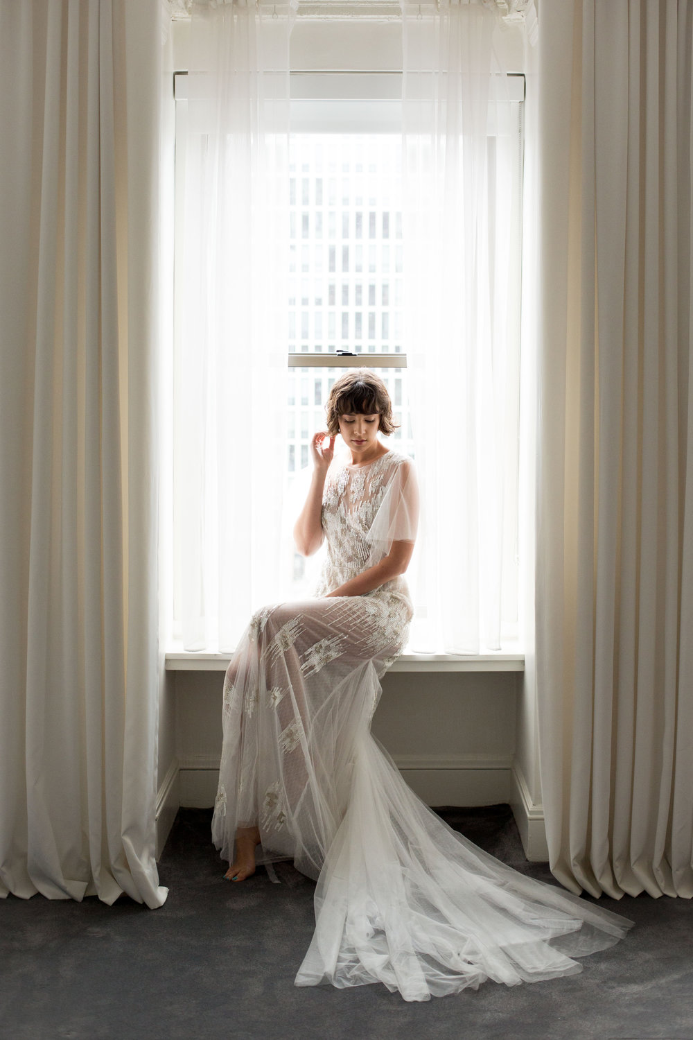 Mickie Gown, mixed netting, tulle and beading with illusion flutter sleeves.