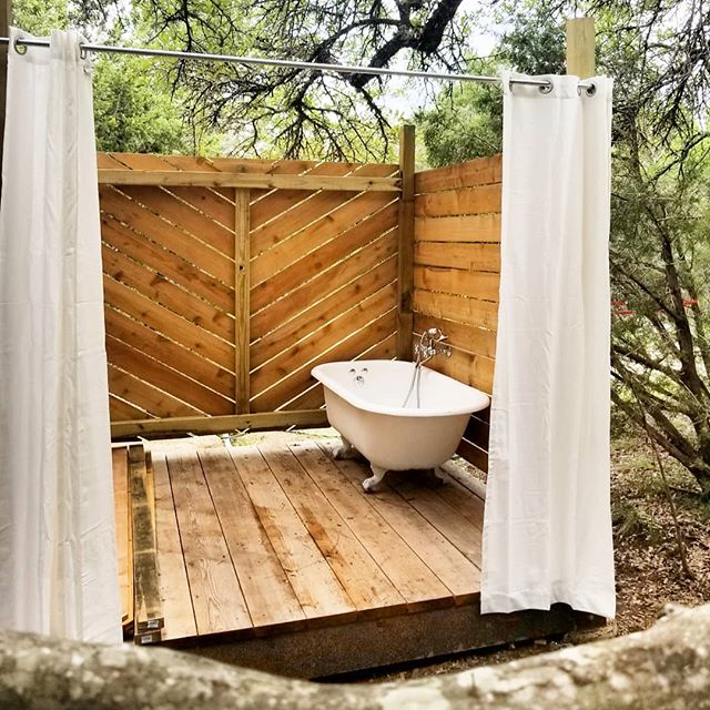 Outdoor shower done! 💦 Progress comes in waves. But now it's plumbed, and ready  with on-demand hot water. The #cedar smells so amazing. Now, for an inaugural bath... ... #outdoorshower #hotwater #diy #permaculture #texas #square #chevron #plankwall #bathtime #homeiswhereyoubuildit #boho #clawfoottub