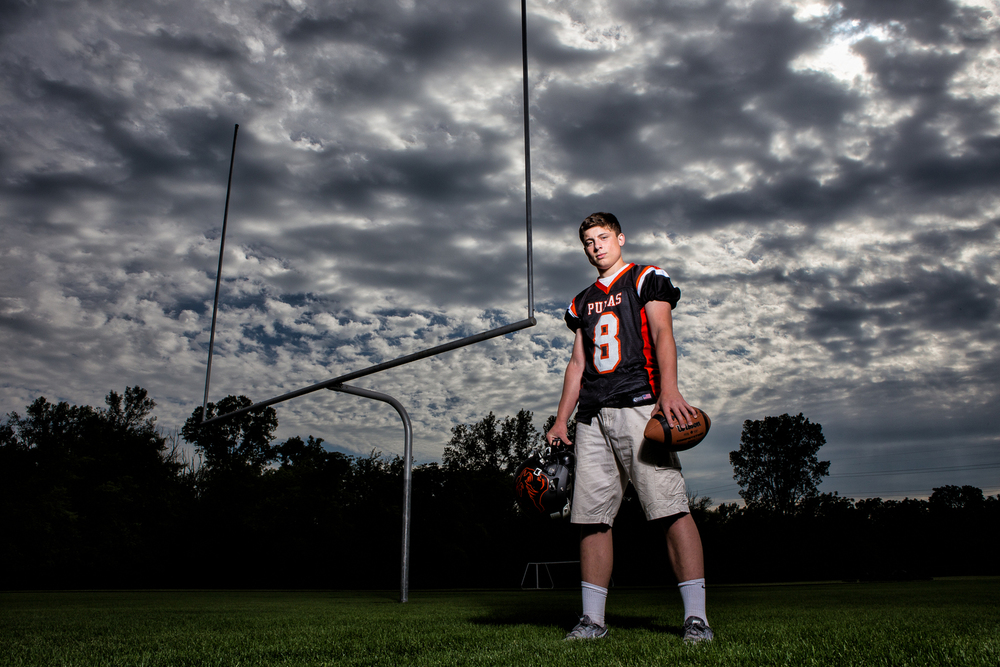 Yes, sports portraits are definitely my favorite! Especially with clouds like this! I used a single off camera strobe to light Tyler as I exposed for the sky. Without using off camera flash, the sky would be blown out and less dramatic.