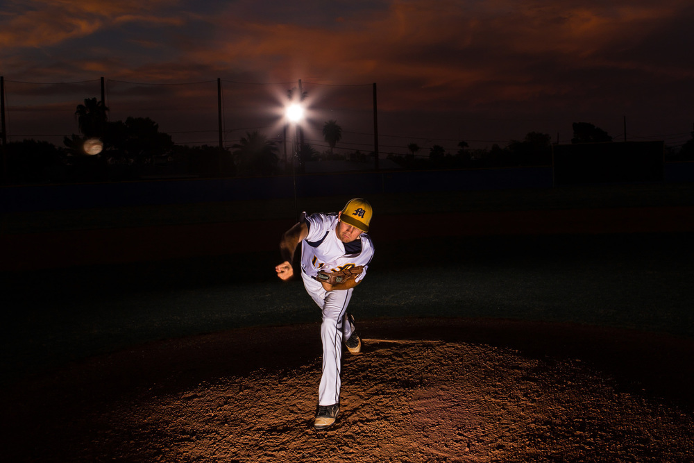 Trevor was a three year varsity pitcher and has great throwing mechanics. This image was taken after sunset and it was nearly dark. I love the dramatic skies Arizona sunsets can create. I used two alien bee strobes to create this image and freeze the motion. It took quite a few attempts to get the ball in the shot but eventually we got it!