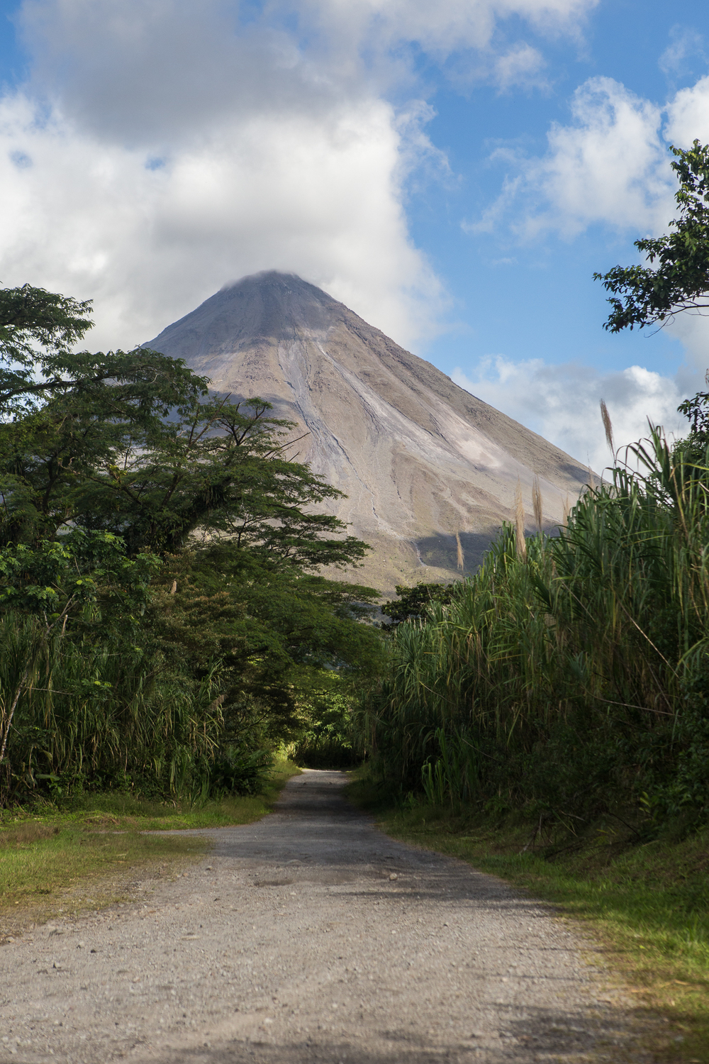 The dirt road entrance at Arenal National Park. You can see the lava trails down the volcano.
