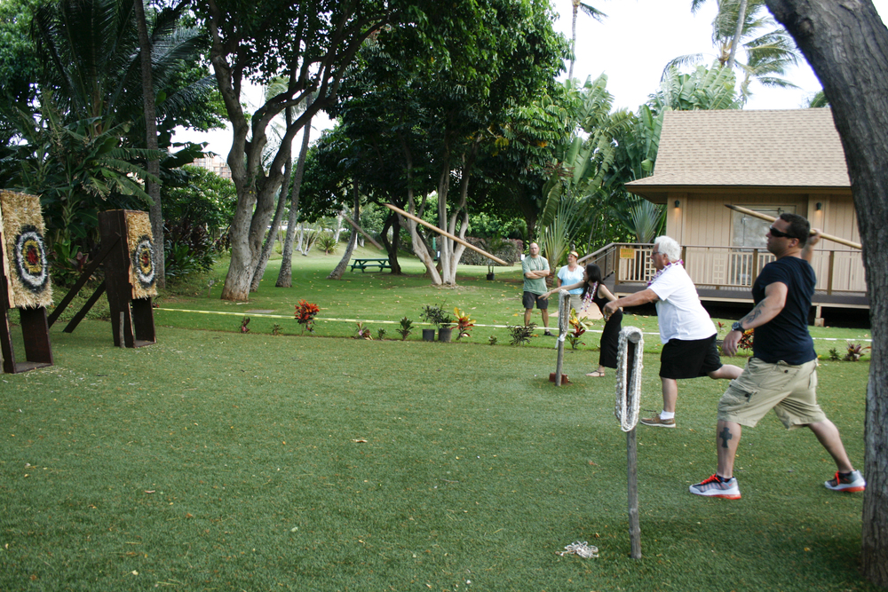 My Dad and Brother trying out the warrior games at Paradise Cove Luau.