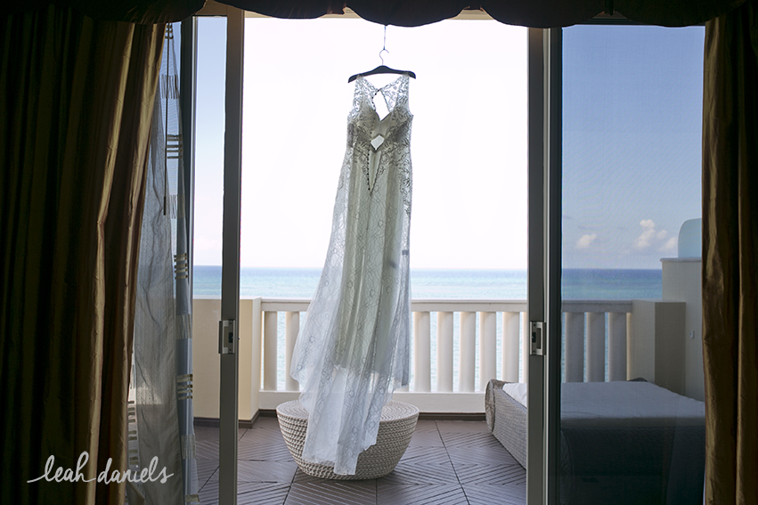 Scariest moment of photographing a wedding dress... beach + wind + gusts of wind + terrace + open doors = scary..... but awesome shot!