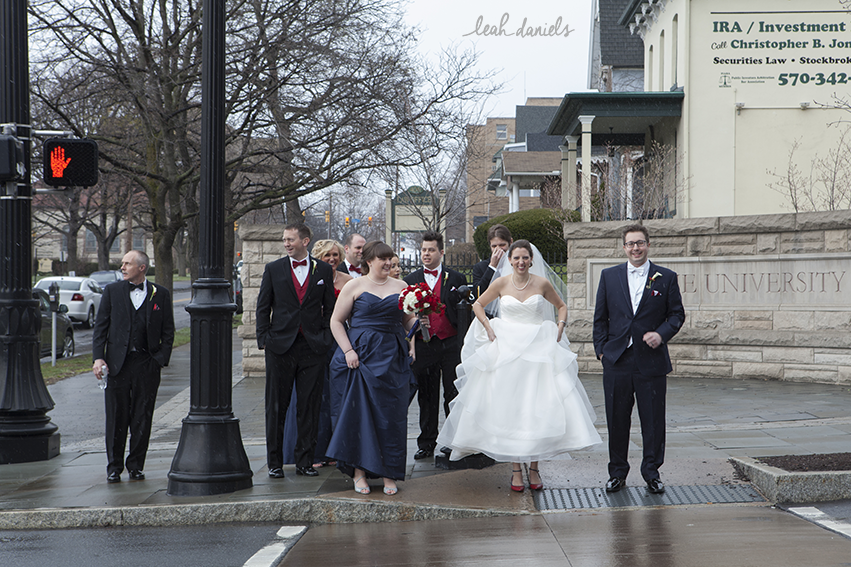 The whole bridal party waiting to cross the street to get to the beautiful campus of The University of Scranton for photographs.
