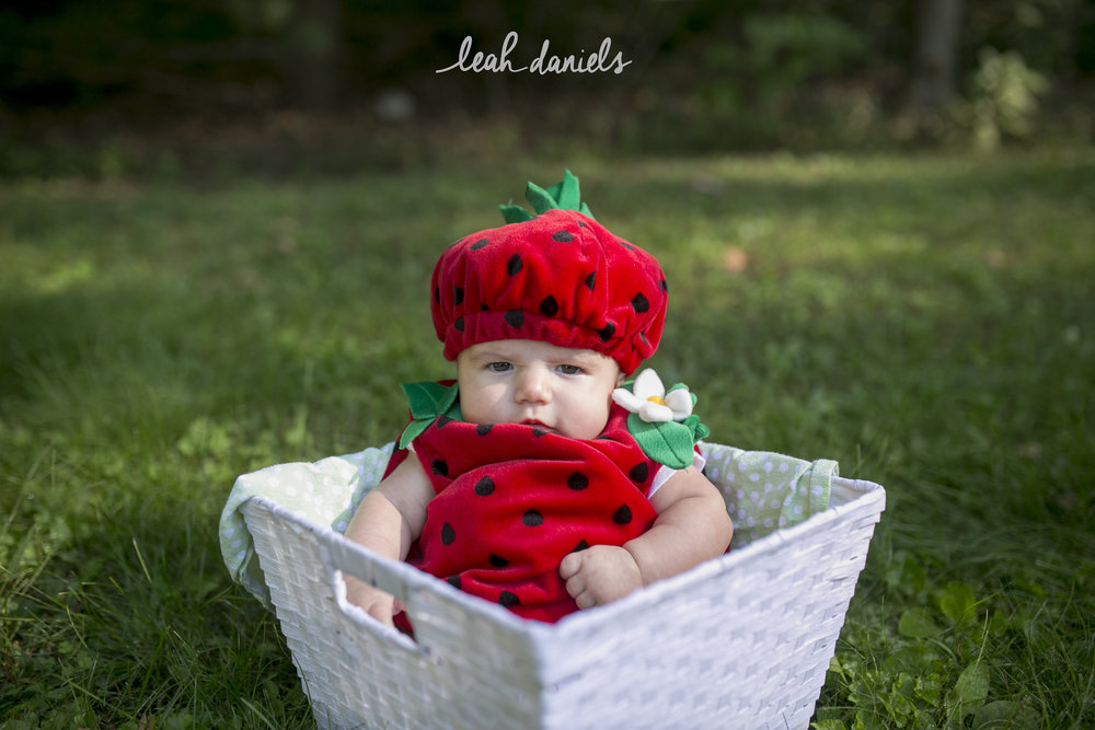 The face you make when you really not sure about why you should be wearing a strawberry outfit.