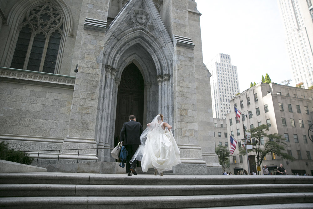 Kyra was escorted by her brother Jamie into Saint Patrick's Cathedral and down the aisle.