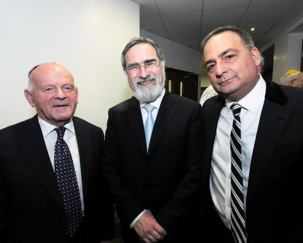 Left Ben Helfgott (president 45 Aid Society, Holocaust survivor) Lord Sachs, the chief Rabbi, Colin Lester at a fund raising dinner to help survivors who are struggling financially.